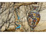 Hanging pot with a height of 40 cm of clay with enamel designs on pottery