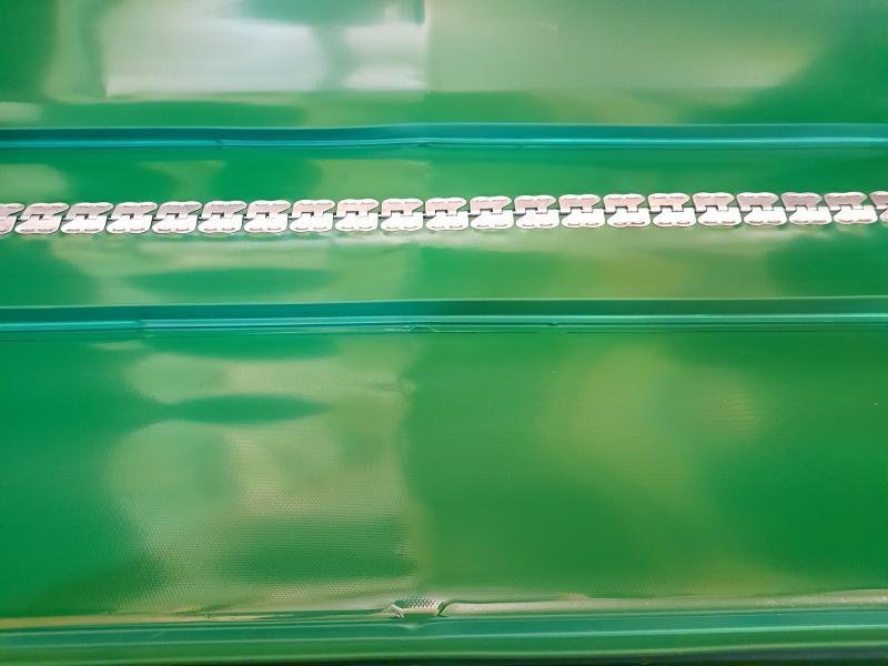 Feed mixer rubber conveyor