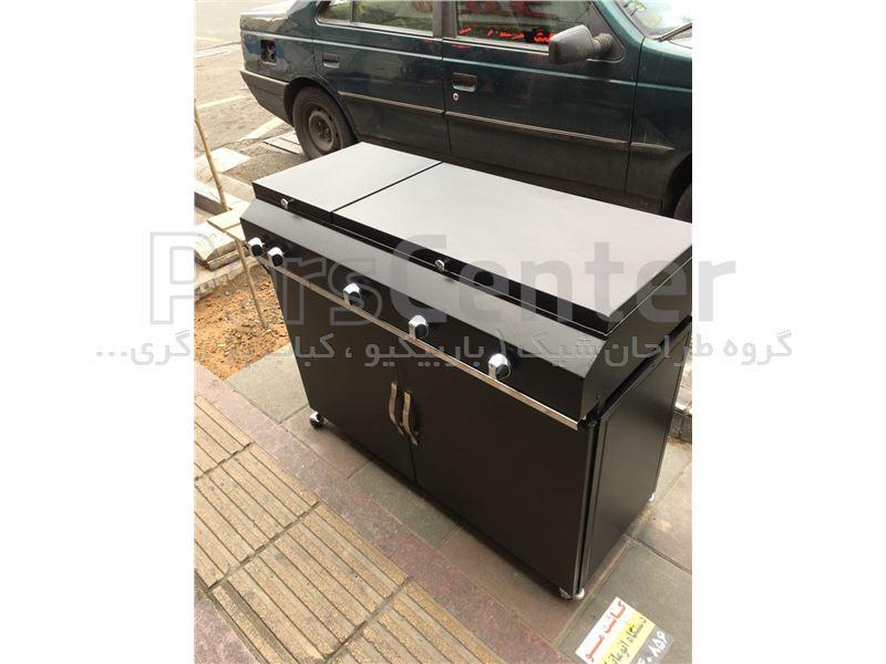 کباب پز گازی 110 سانتی  با شعله بغل 2 ردیفه با پایه کابینت دار با میز تاشو چوبی