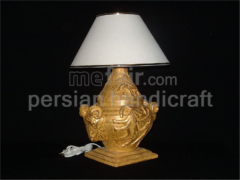 Cow with golden glazed earthenware lamp design