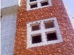 اجرای نصب سنگ آنتیک بر روی نمای ساختمان