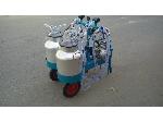Belt type portable milking machine